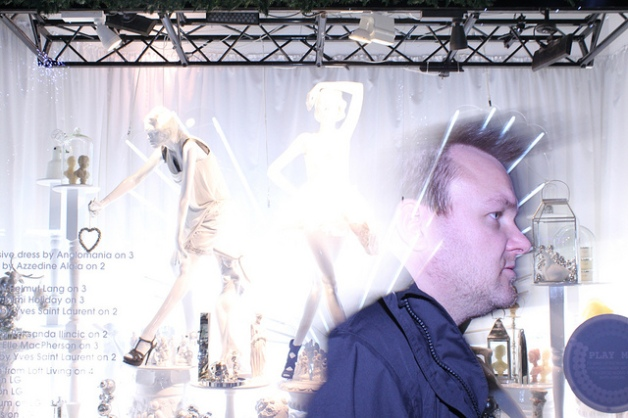 Man blends with shop window Selfridges 2011