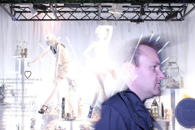 Man blends with shop window Selfridges 2011